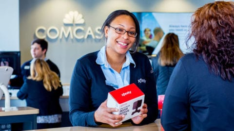 woman inside a retail comcast store