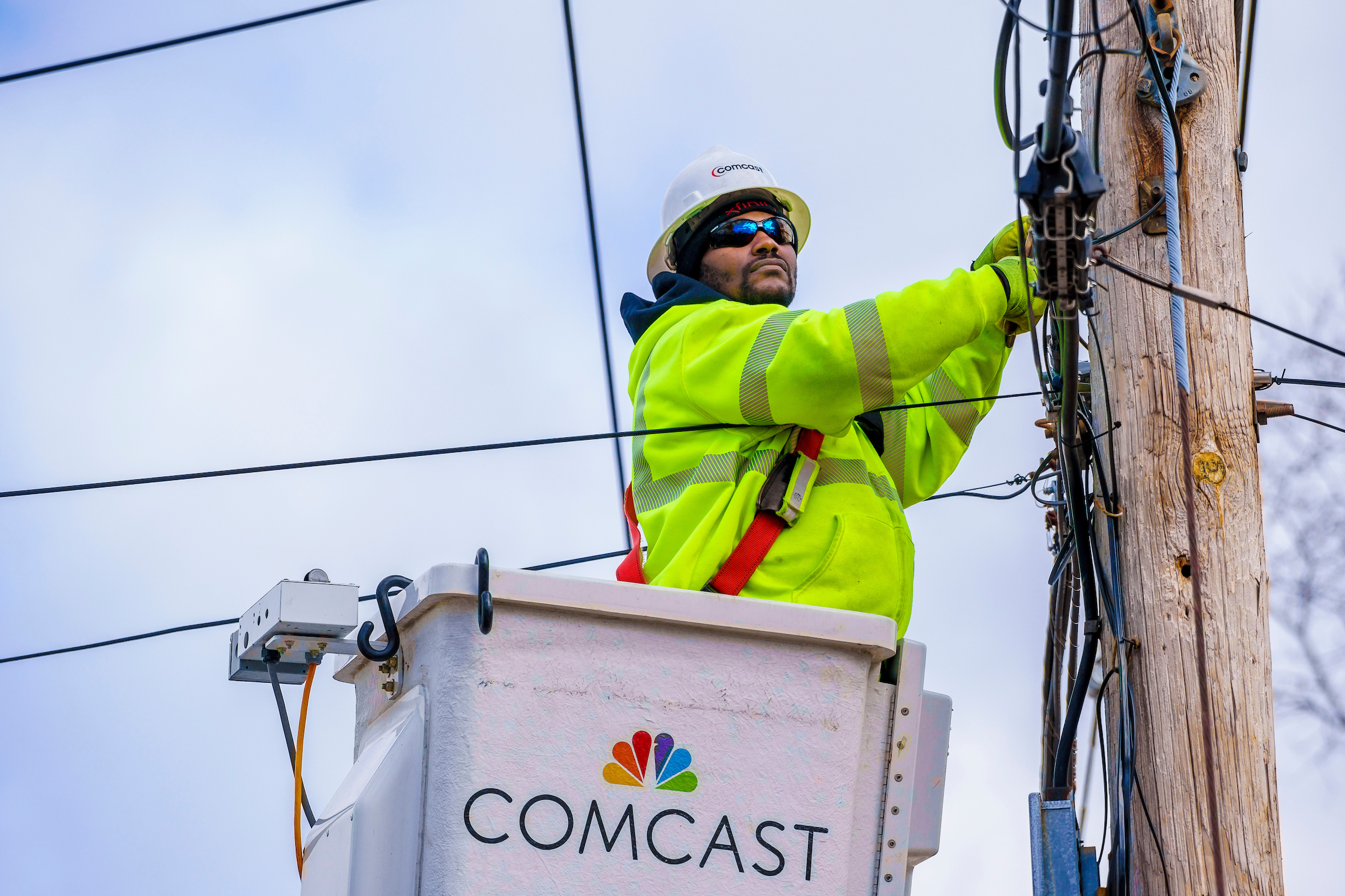 comcast worker working on wires